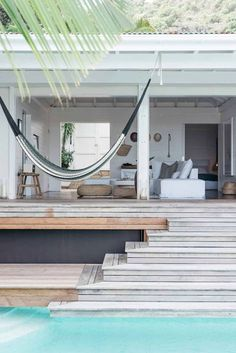 outdoor room with hanging hammock and pool