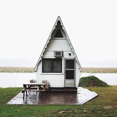 This tiny home is on the Mississippi River near Hamilton, IL, and it's seriously one of the most adorable things we've ever seen. The shape alone is enough to make anyone swoon — looks like something you'd find at Disney World.