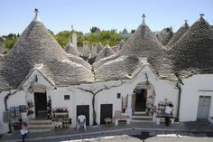 Visit the Trulli of Alberobello, an UNESCO World Heritage Site, from Naples on this private tour. Learn about the mortar-less constructed buildings, a prehistoric building technique. Marvel at these unique limestone buildings with their conical roofs Alberobello Italy, Puglia Italy, Construction, Architecture, Naples, Small Towns, Barcelona Cathedral, Places To Go, Europe