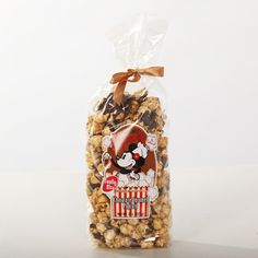 Disney's Main Street Popcorn Chocolate Caramel Popcorn, 8 oz. This product is available as part of our custom gift builder or as an addition to any floral or gift purchase, however, it cannot be purchased individually. Disney Presents, Mickey Ears, Disney S, Main Street, Customized Gifts, Caramel, Disney Dreams, Chocolate, Popcorn