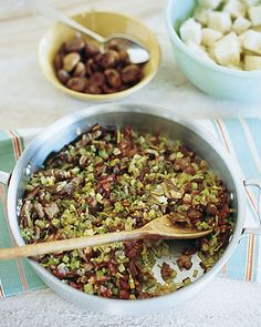 Porcini, Chestnut, and Sausage Stuffing | Martha Stewart Living - Sauteing the ingredients the night before Thanksgiving saves time, and allows the flavors to meld.