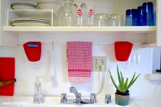Install a tension curtain rod ($4.99 here) above your kitchen sink to make it easy to find your towel and sponge. | 7 Easy Organizing Tricks You'll Actually Want To Try