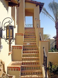 Mediterranean Staircase with Talavera tile, Wrought iron railing, Maxim scottsdale high country forge outdoor wall light Mediterranean Style Homes, Mediterranean Architecture, Exterior Tiles, Tile Stairs, Stucco Walls, Style Tile, Staircase Design, Stairways, Villa