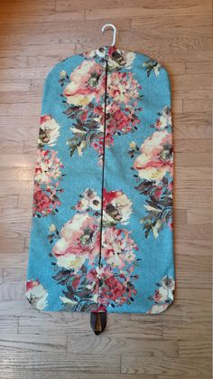 Hanging Garment Bag, Turquoise Bouquet Garment Bag, Weekender by CarryItWell on Etsy Turquoise Bouquet, Rebecca Brown, Etsy Cards, Turquoise Background, Garment Bags, Green Accents, Grosgrain Ribbon, Pink Flowers, Plane