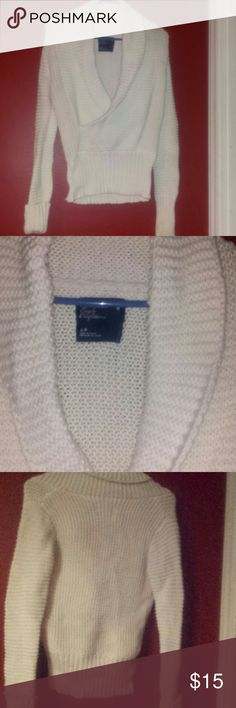 American Eagle small petite vneck cardigan It is cream colored and has a kong v neck front and long sleeves that roll up made of cotton and  acrylic  RN 54485 CA 03873 American Eagle Outfitters Sweaters V-Necks