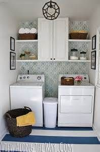 I love the wallpaper and the balanced look of this laundry room.
