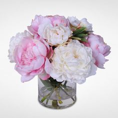 Bring the beauty and splendor of a Silk Peony flower arrangement into your home. This design features an arrray of select White and Pink Silk French Peonies, de