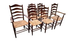 This is a set of eight ash and rush dining chairs designed in the late 1800s by Ernest Gimson and made by Neville Neal at some time in the 1950s. Each chair is stamped NEVILLE NEAL inside the rear leg.   Neal was apprenticed to Gimson