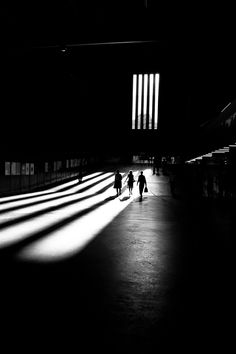 Tate Mordern, London... shadows. light and women in the big hall