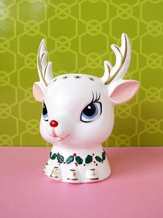 White ceramic Christmas deer head. I have one IDENTICAL to this but it has a santa standing between the antlers and they are actually candle holders for taper candles.