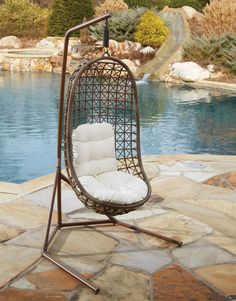 This chair has a tropical feel to it with a modern Espresso wicker weave. Made by Panama Jack, the Island Cove Hanging Chair uses a patented ViroFiber that is UV resistant so it won't fade or crack. This chair differs from others on the list because it has an open and more boxed base while others have a circular base. This would allow you to pull it up closer to other chair or maybe right up to a table if you're feeling extra lazy. The only caveat is that you wouldn't be able to swing around…