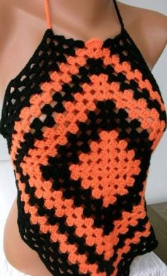 Orange Granny Squares Top. Was on etsy, but it no longer seems to be available. If you're inspired to knit one yourself, let me know.