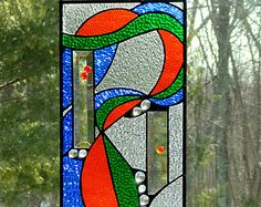 Yin yang suncatcher fire and ice stained by DesignsStainedGlass