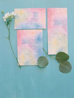 Watercolor rainbow invitations: http://www.stylemepretty.com/destination-weddings/2014/12/10/maui-rainbow-wedding-inspiration/ | Photography: Wendy Laurel - http://www.wendylaurel.com/