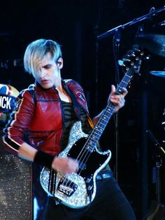 Mikey Way and his glittery bass.<<<to be more specific, Mikey Way and his gorgeous Squier Mustang bass that is almost as perfect as him.