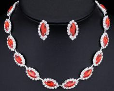 """""""Pomegranate Grains"""" Jewelry Set. The garnet stones bypassed with tyny crystals make an impression of pomegranate grains in sugar. It will look very attractive with black, red, white, purple and violet dress. You may complete your image with black gloves."""