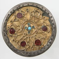 Disk Brooch Date: century (?) Culture: Frankish Medium: Silver, coated with gold, wire, glass, paste - The Metropolitan Museum of Art. Medieval Jewelry, Ancient Jewelry, Medieval Art, Antique Jewelry, Wiccan Jewelry, Carolingian, Asian History, British History, Oriental