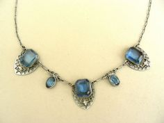 Hey, I found this really awesome Etsy listing at http://www.etsy.com/listing/127887208/aqua-glass-art-deco-necklace