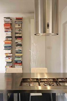 Cool bookcase idea  Cube House / Studio Schiattarella.   Floating shelf?