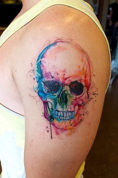 Even when tattooed to look like watercolors, skulls still look cool! I would have this type on my body...I like it!