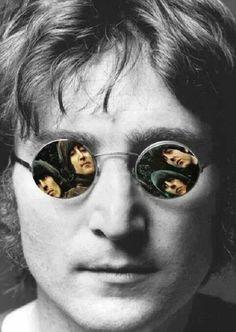John Lennon wearing glasses...
