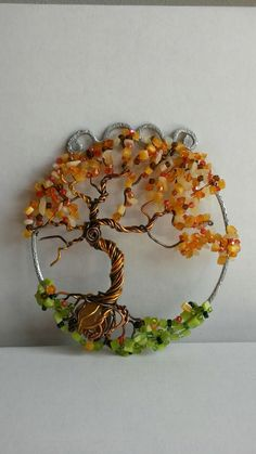 Wire wrapped beaded sun catcher with Tree of life.