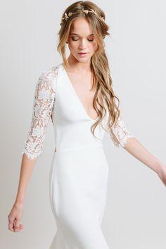 Three quarter length lace sleeved wedding dress by Sarah Seven