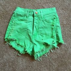 Green high waisted shorts Worn once. Super comfy has a little stretch too them too! Makes you look super tan that's why I loved them but they're too small :( sizing can fit XS or small Shorts Jean Shorts