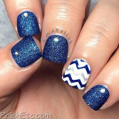 A wonderful looking blue and white nail art design. The design uses midnight blue glitter polish for the starry effect while white is used s base color with silver glitter polish on top for the zigzag details.