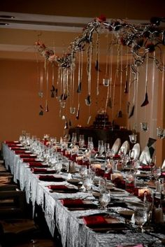 use a fake chain draped over the table and hang ghoulish stuff from it with fishing wire