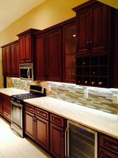 1000 images about backsplash on pinterest glass subway for Cherry kitchen cabinets with white appliances