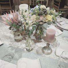 テーブルデコレーション 大人っぽいピンク色をキャンドルのカラーで出すのも綺麗でした❤︎ #TRUNKデコレーション  #trunkbyshotogallery #渋谷#shibuya#wedding#結婚式#flower#お花#decoration#display#プレ花嫁#ゼクシィ#DIY#love#会場 #装飾#オシャレ#可愛い#bouquet#ブーケ シャーベットカラー プロテア キングプロテア pink gray protea