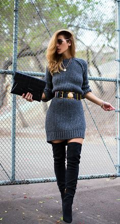 This charcoal gray sweater dress w/ thigh high black boots & purse is nothing short of stunning! The black & gold statement belt brings the whole look together flawlessly.