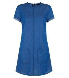 """Layer this blue denim tunic dress under a check coat and add lace up block heel ankle boots - for a effortless daytime style this season.- Patch pocket front- Rounded neckline- Turn up short sleeves- Casual fit- Zip back fastening- Soft cotton fabric- Model is 5'8""""/176cm and wears UK 10/EU 38/US 6"""