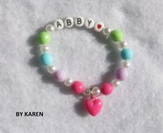 Check out this item in my Etsy shop https://www.etsy.com/listing/216247576/girls-beaded-name-bracelet-with-acrylic