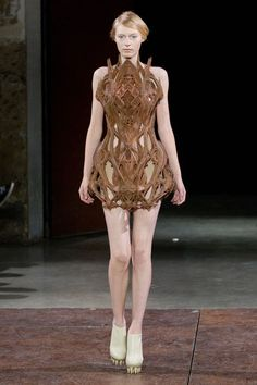 How did she get into this?! This sort of reminds me of a fancy outfit a Fantasy character would wear. A druid perhaps.