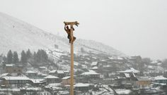 A man climbing a wooden block to win the contest during the celebration of Maslenitsa, or Pancake Week at Russia, March 14, 2013.