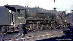 """Stanier, LMS (built North British, Glasgow, """"Jubilee"""" class 45597 """"Barbados"""" at York MPD - 45597 was withdrawn in January 1965 and scrapped in April the same year. Abandoned Train, Abandoned Amusement Parks, Abandoned Places, Abandoned Castles, Abandoned Mansions, Diesel Locomotive, Steam Locomotive, Steam Trains Uk, Old Wagons"""