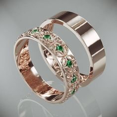 14K rose gold rings in Celtic flower style set  with natural Emeralds. This set was designed as if the woman's ring was crafted out from the man's ring to symbolized how each part complete the other. While wearing these bands you take a part of your loved one with you.  #WeddingRingsSet #HisAndHersBands #WeddingBands #EmeraldsWeddingBands #EternityWeddingSet #EtsyWedding