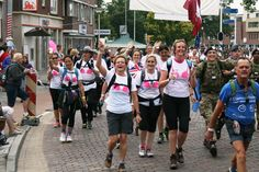 Day 1 of the #Nijmegen Marches... the team set off around 5am local time for their first 40k of the week! Here's the team going through the town of Elst... over half way... looking good in their bra t-shirts don't you think?... will keep you all posted #WalktheWalk