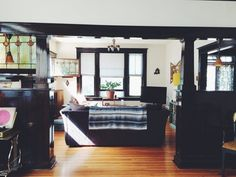 Natalie's Cozy, Contrasting Home Full of Character — House Call  --- interested in the contrasting trim.... it would probably just draw attention to the wrong things in our home....