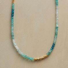 """ULTRAMARINE NECKLACE -- Our stream of apatite and aquamarine basks in the glow of 22kt vermeil beads. Wear this apatite, aquamarine and gold vermeil necklace long or double. Handmade in USA with hook clasp. 40""""L."""