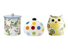 """Change the look of your counter faster than you can say """"cookie."""" Katie Alice English Garden 7 3/4""""H x 6 1/4""""-diameter cookie tin, $20, pfaltzgraff.com; Bright Dot Happy Everything 8 1/2""""H x 9""""-diameter ceramic jar, $43, coton-colors.com; Owl 9 3/4""""H x 7""""-diameter ceramic jar, $40, pier1.com"""