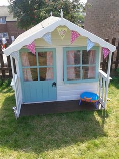 Erin and Leah& wooden playhouse as always the clever husband built it and I got to paint it and make it pretty. Kids Wooden Playhouse, Little Tikes Playhouse, Playhouse Decor, Outside Playhouse, Girls Playhouse, Garden Playhouse, Build A Playhouse, Playhouse Outdoor, Playhouse Ideas