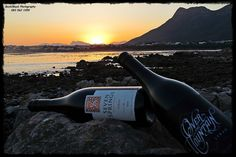 Golden sunset over two Gold Decanter World Wine Award winning wines. #discoverOverberg for beauty and great wines