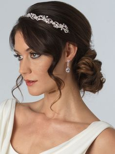 Bridal headband in silver tone pairs the delicate rhinestones with Swarovski crystals that have been securely hand wired for ease of wear.