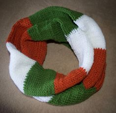 Handknit+infinity+scarf+resembling+the+Irish+flag+and+Irish+colors.+Green,+orange,+and+white+are+used+to+accomplish+this+look.  One+size+fits+most.+ About+27+inches+in+length.  Kelly+green,+Terracotta+orange,+and+white+are+all+100%+Acrylic+and+this+item+is+machine+wash&+dryable.