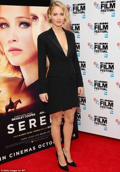 Jennifer Lawrence attended the London Film Festival premiere of her new movie Serena in a plunging black tuxedo-style dress http://dailym.ai/1sNZkxp