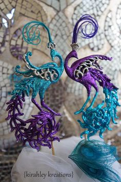 PEACOCK Wedding Cake Toppers -- Stunning & Sparkling Turquoise Teal, Regal Purple and Silver Glittery Peacocks w/ Herl Feathers Decoration by KirahleyKreations on Etsy https://www.etsy.com/listing/168975253/peacock-wedding-cake-toppers-stunning