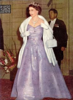 Queen Elizabeth in lilac evening gown,fur wrap and long gloves arrives at Melbourne Theatre /1953/